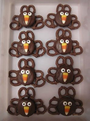 Turkey Treats-- Dip Oreos in melted chocolate- Add eyes (Wilton Candy eyes) and candy corn for the nose with frosting. Place on chocolate frosted pretzels