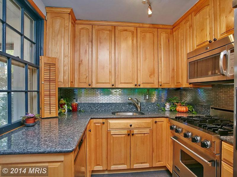 Blue Pearl Granite Countertops (Pictures, Cost, Pros and Cons) #honeyoakcabinets Honey oak cabinets with blue pearl granite #honeyoakcabinets Blue Pearl Granite Countertops (Pictures, Cost, Pros and Cons) #honeyoakcabinets Honey oak cabinets with blue pearl granite #honeyoakcabinets