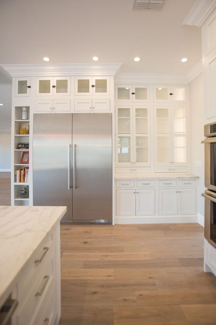 Contemporary, white kitchen with Shaker cabinets, marble ...
