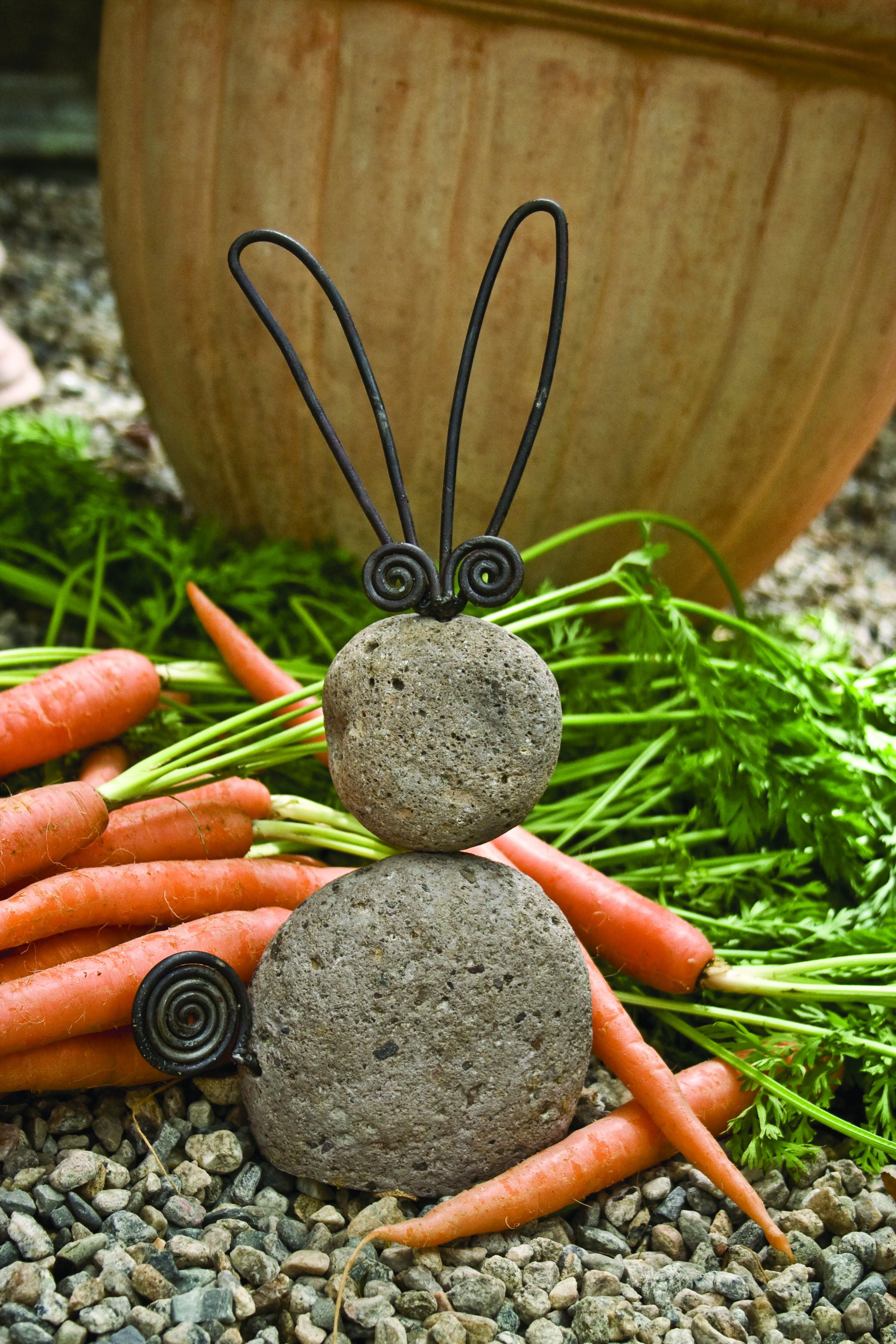 Silly wittle wabbit. Add character to garden décor with this ...
