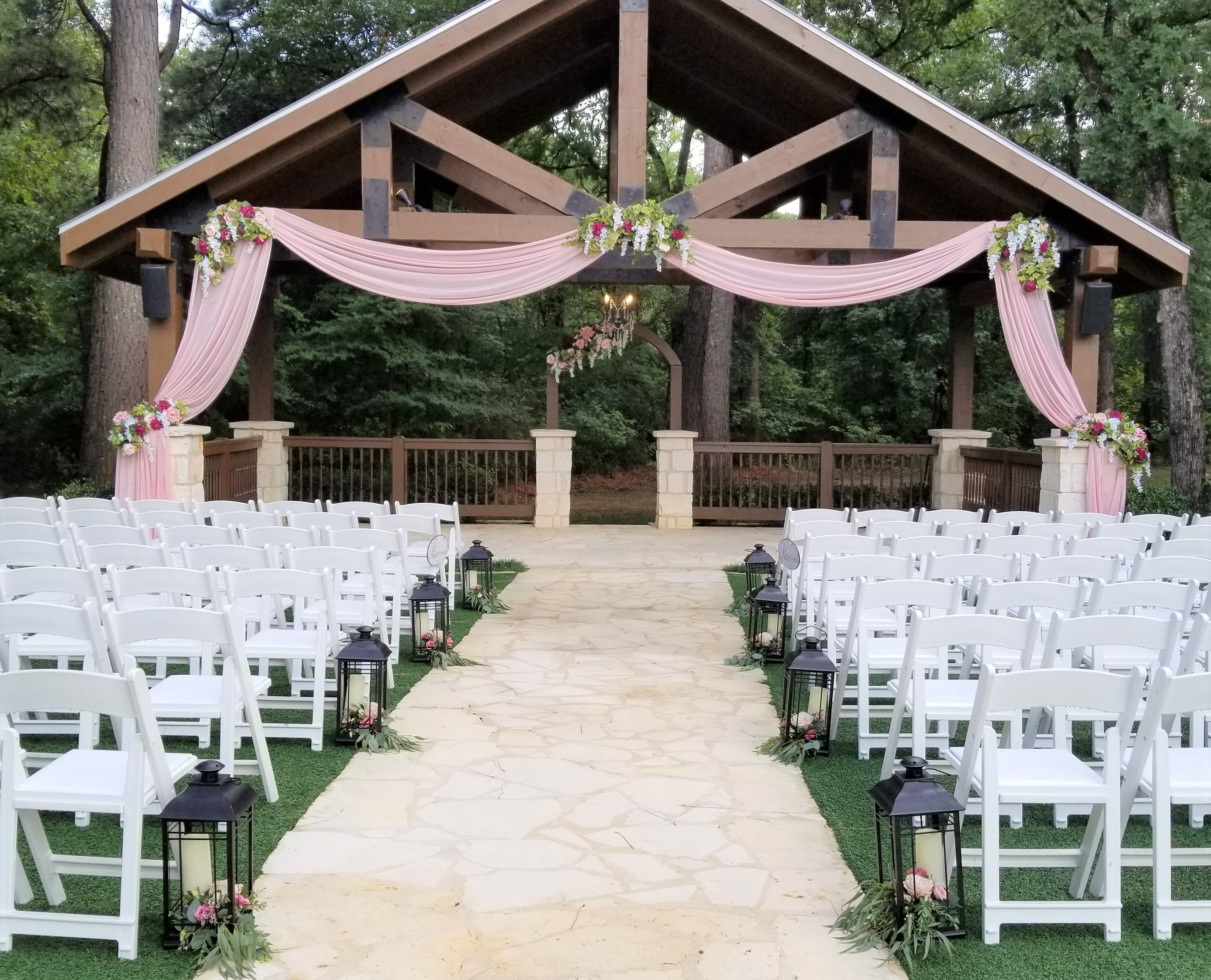 Rose Gold Draping With Flowers On The Gazebo And Lanterns Down The Aisle Www Wildroseevents Com Wedding Florist Wedding Wild Roses