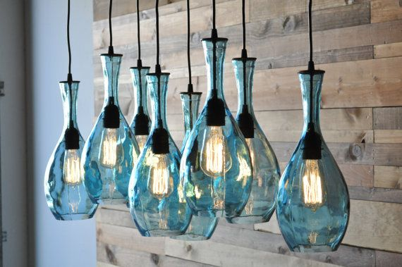 8-Light Hanging Lamp Chandelier with Repurposed Spanish Glass Bottles. on Etsy, $956.53 CAD