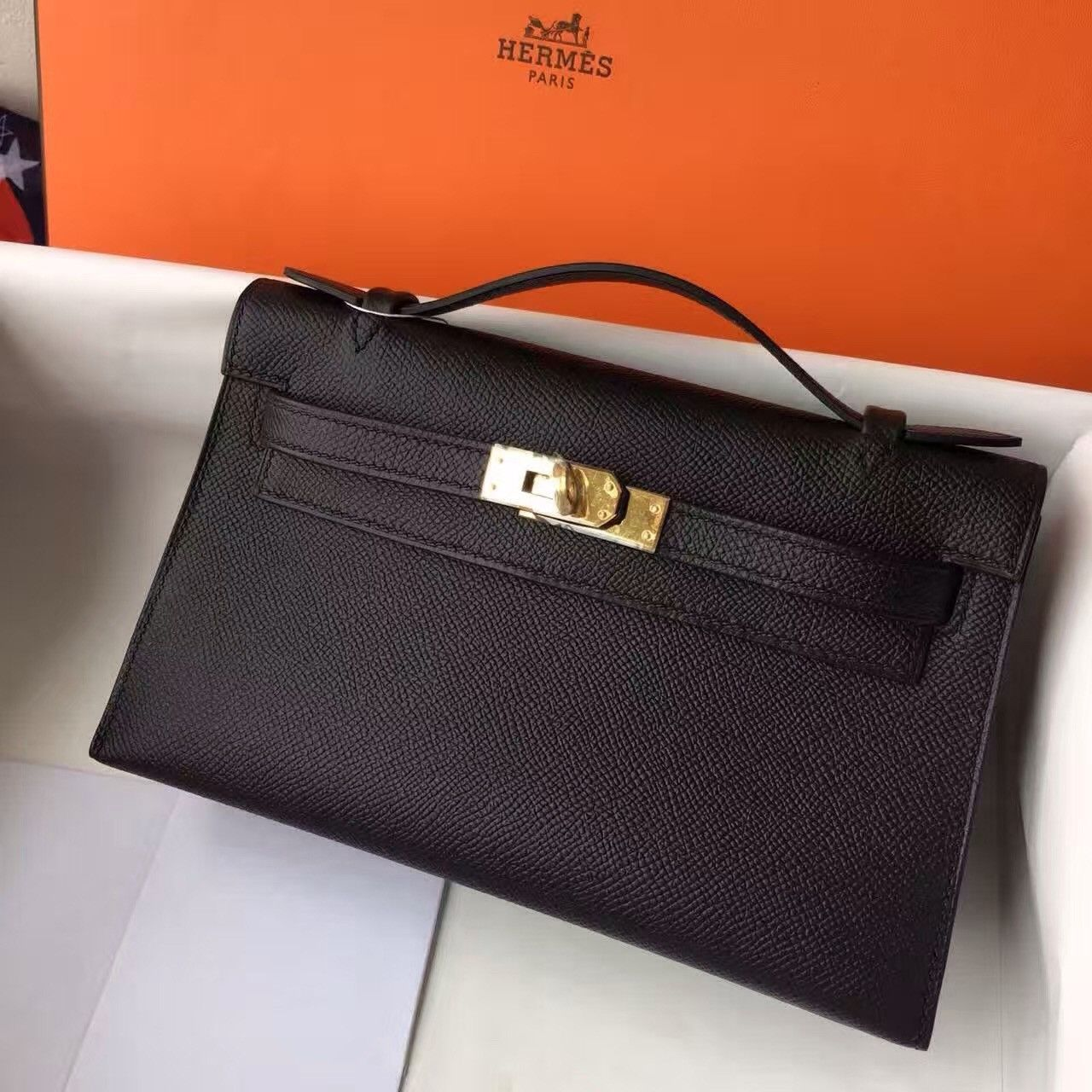 7fe0f14548 This Authentic Hermès Black Epsom Mini Kelly Pochette with Golden Hardware  is in pristine condition  never before carried with the protective plastic  intact ...