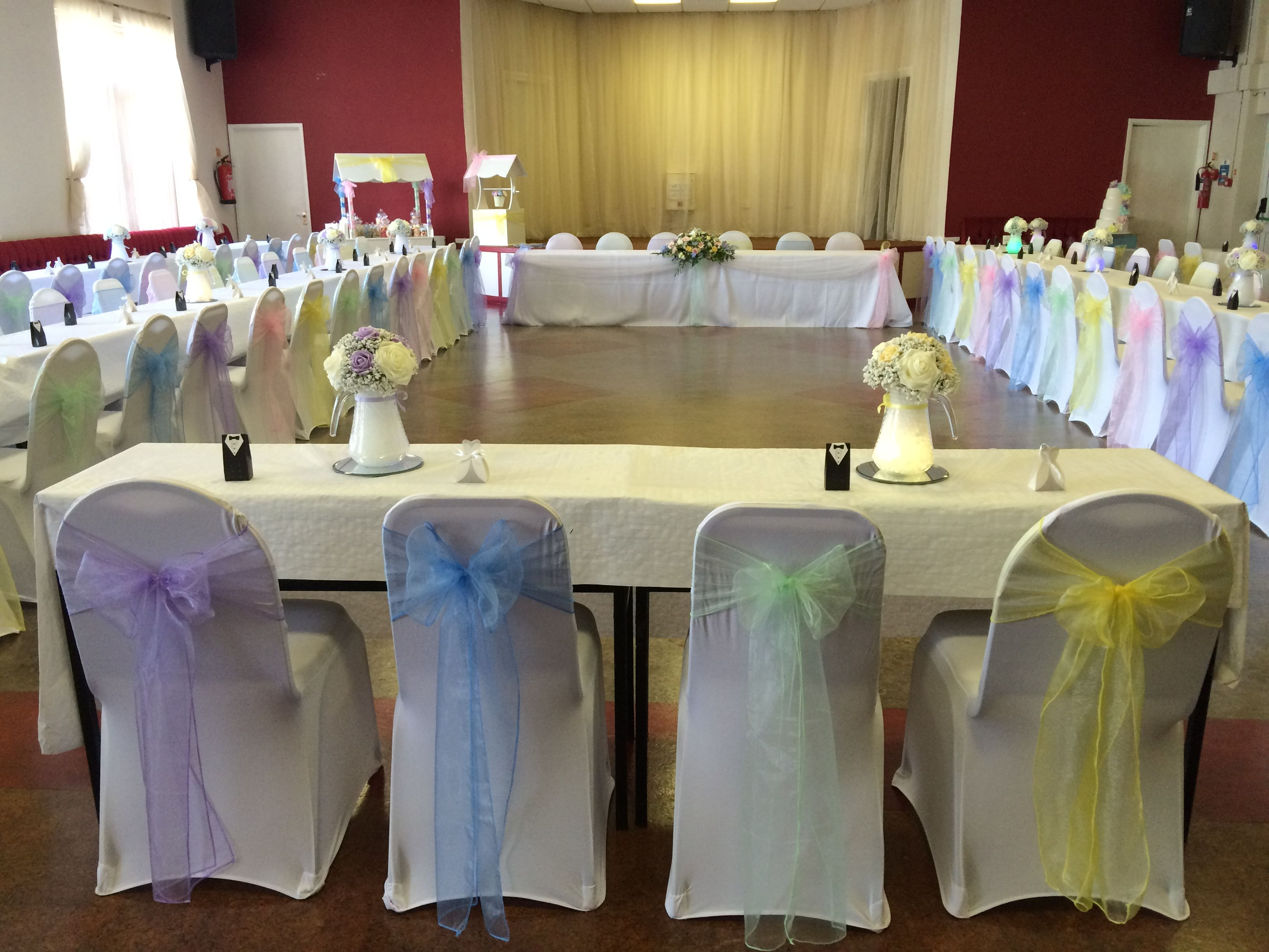 Pastel Rainbow Sashes On White Chair Covers In Maesteg South Wales Venue Dressed By