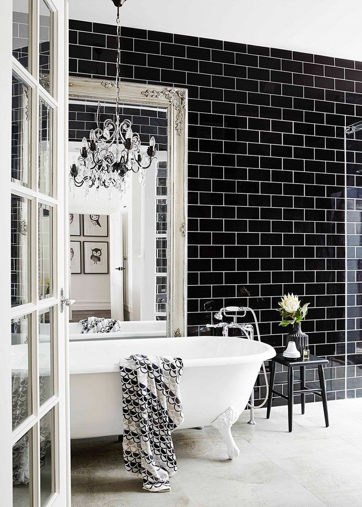 Opulent black and white bathroom with chandelier
