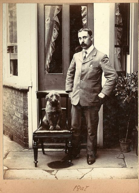 Edwardian man and dog, 1907  Fashion has changed only incrementally in the years since 1907, but our pooches remain pooches, whatever the style.