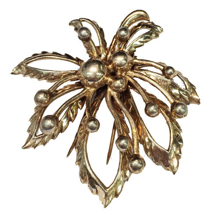 Vintage designer brooch by O S K A