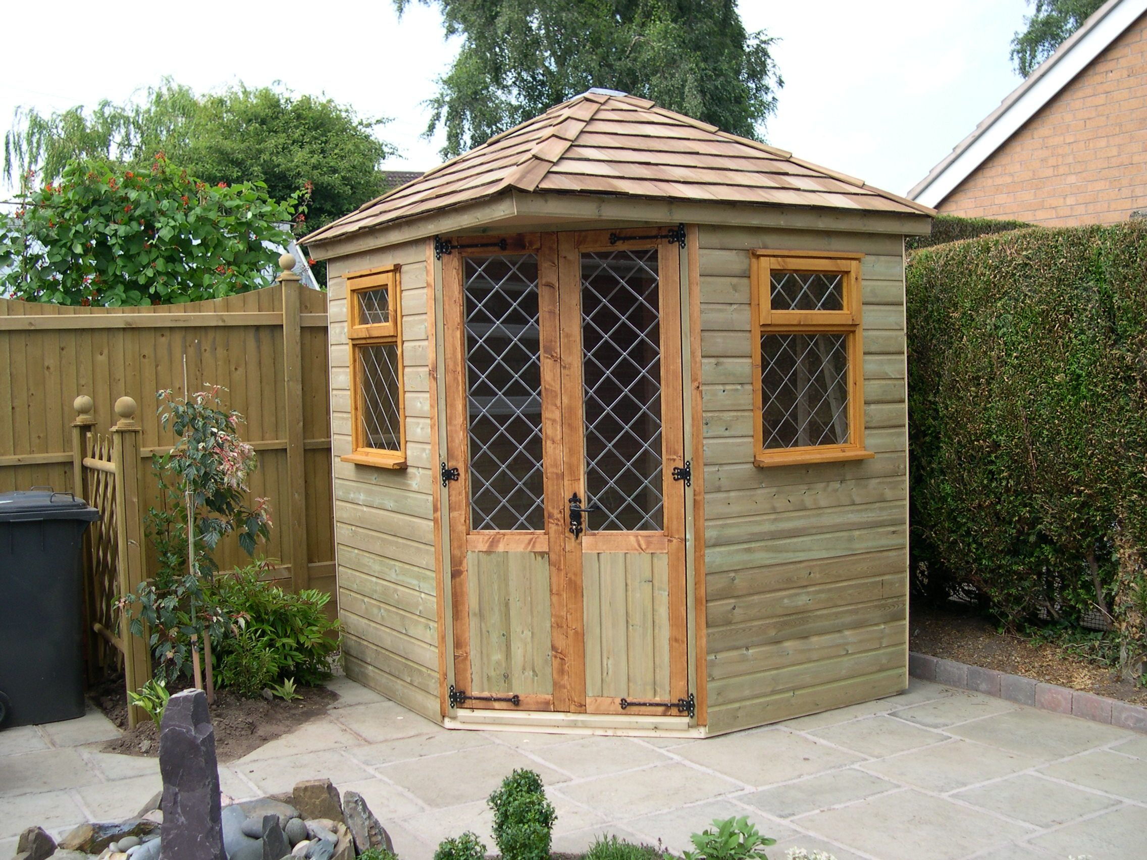 Corner Summerhouse Ideas To Spice Up And Beautify Your Garden