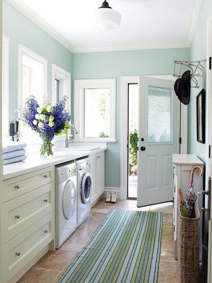 fresh and cheerful laundry room/mudroom - love that wall color