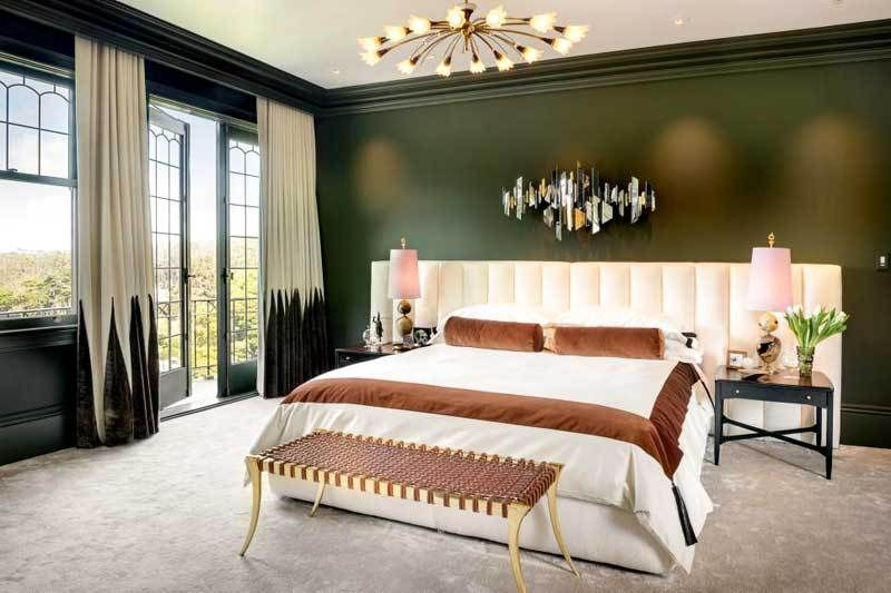 Hunter Green Bedroom With White Bedding And Dark Floor