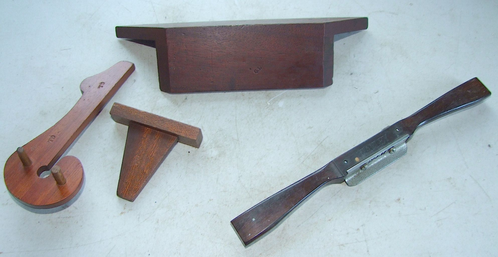 For reference. Group of mahogany layout tools; a miter gauge, a center finder, and a dovetail gauge; all in fine shape and ready to use; left: