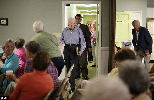Jimmy carter attends church worship service in georgia on sunday surprise former president jimmy carter above reaches out to greet people as he m4hsunfo