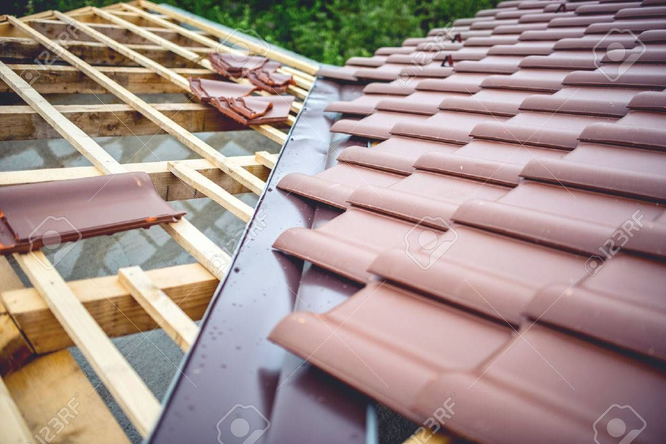Roof Building At New House Construction Brown Roof Tiles Covering Estate Affiliate House Construction Ro Roofing Types Of Roofing Materials Cool Roof