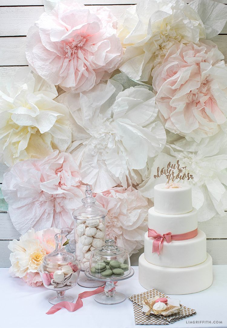 Paper flowers are a gorgeous way to decorate a wedding and you make a beautiful diy wedding backdrop with paper flowers solutioingenieria Image collections