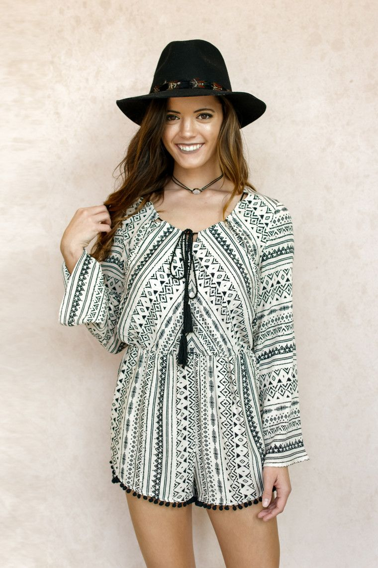 Long sleeve printed romper with pom pom trim. Still on the hunt for that perfect Coachella outfit? Look no further, here it is! This cute printed romper would be a hit for sure. 100% Rayon Hand Wash C