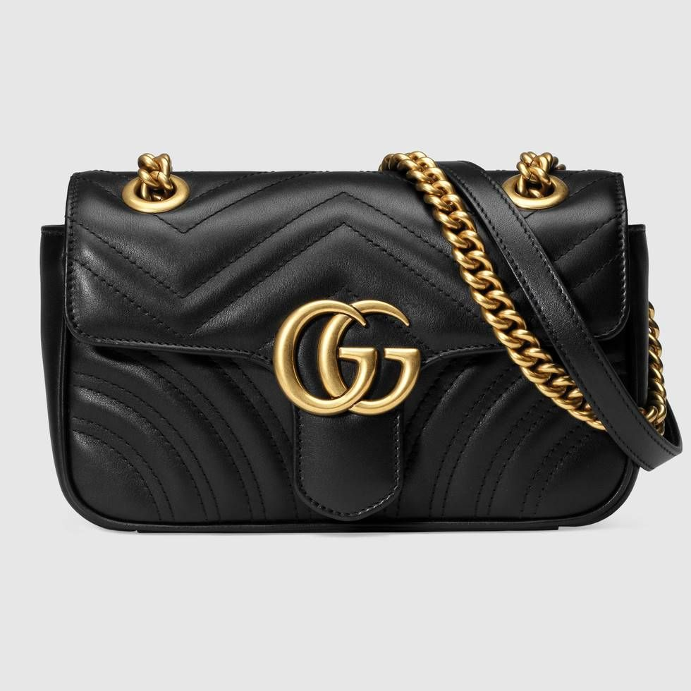476acba318a99f Shop the GG Marmont matelassé mini bag by Gucci. The small GG Marmont chain  shoulder bag has a softly structured shape and an oversized flap closure  with ...