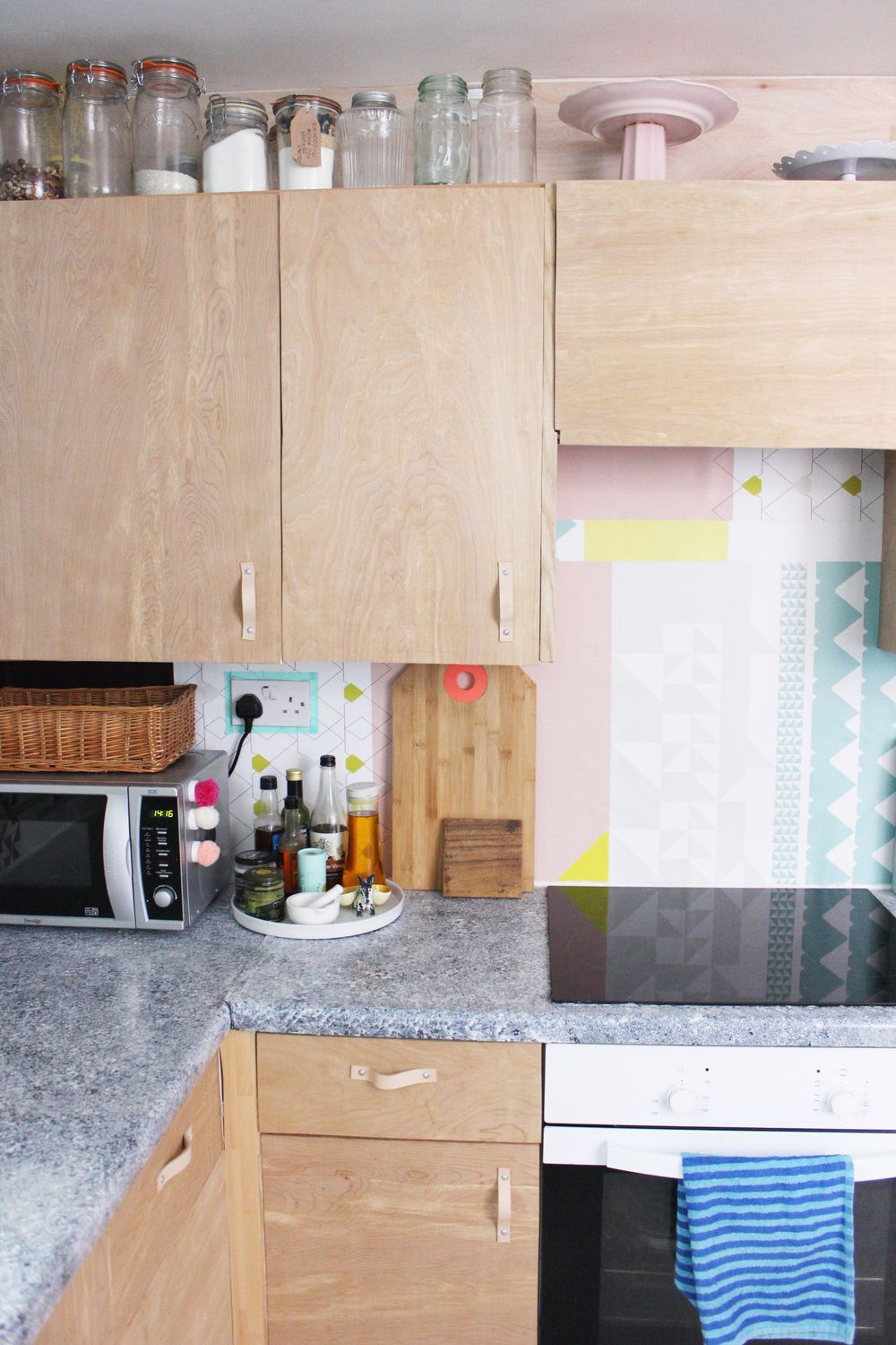 a modern diy kitchen makeover on a budget. love the plywood cabinets