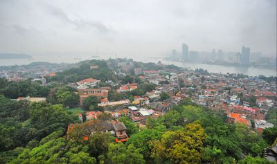"""A scenic view of Xiamen from Gulangyu islet, where European architecture attracts visitors to its """"pedestrians only"""" streets."""