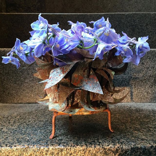 """""""Rest on a bed of blue delphiniums"""" arranged in an  original vase by #tageandersen made from metal leaves - ask for the 'løvvase' in our shop at Ny Adelgade 12. #flowercomposition #floweroftheday #bouquetoftheday #instaflowers #uniqueart #nordicmood #copenhagen:"""
