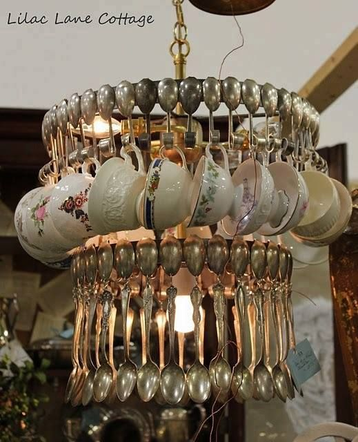 Chandelier of old silver spoons and mismatched cups!