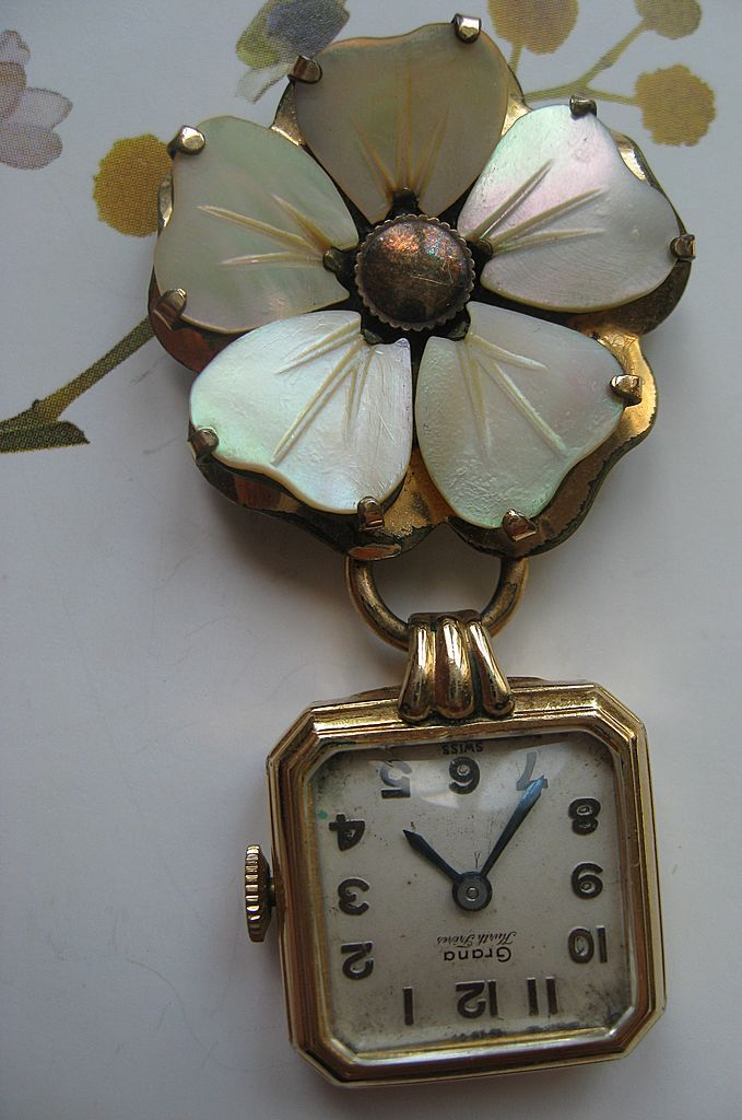 OOH< this might be the one...Garner Pendant Watch Mother of Pearl Pin.