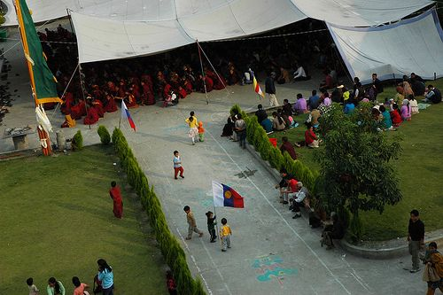Tibetan Children Playing Claim This Place For Buddhism With The International Buddhist Flag Overflow
