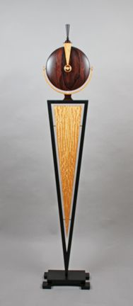 "RELIQUARY - GEO DECO  Zircote, Figured anigre, Ebonized ash, Brass supports  54 x 10 x 6"" diameter by Alan Carter"