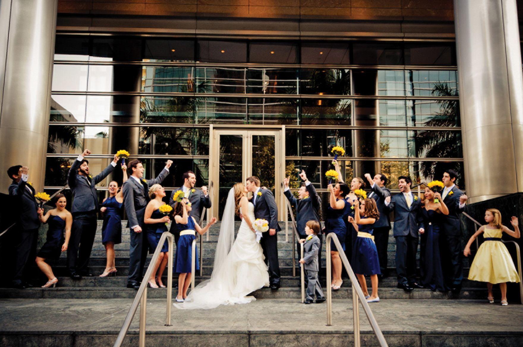 Sunny yellow pops against navy bridesmaid dresses and suits at sunny yellow pops against navy bridesmaid dresses and suits at four seasons hotel miami ombrellifo Images