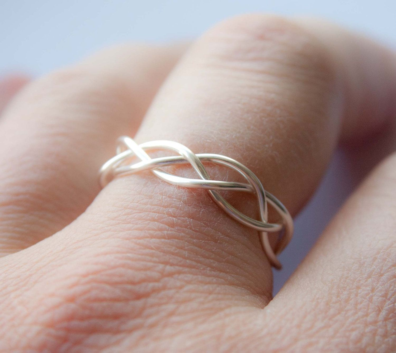 Braided wedding band to go with a solitaire engagement ring