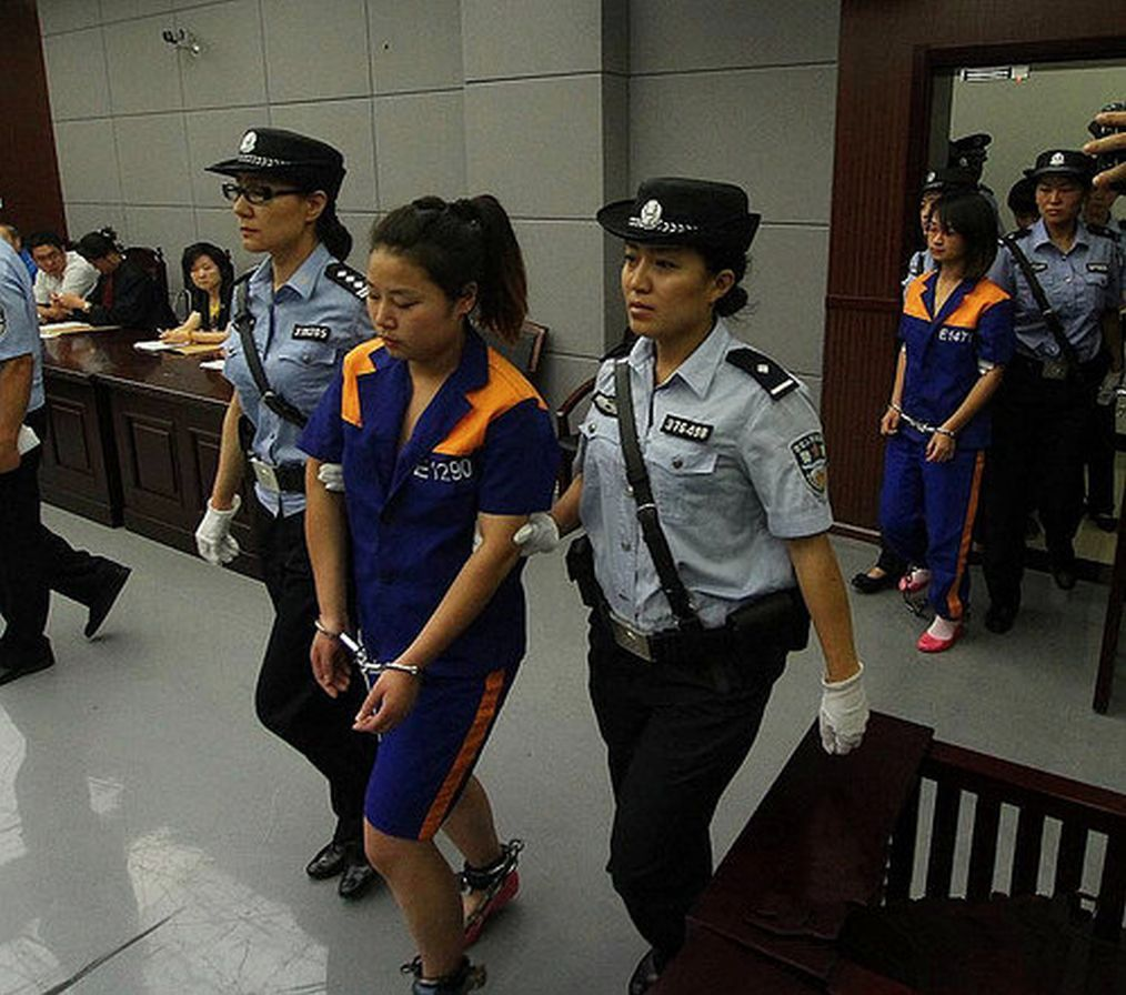 Woman Handcuffed Shackled Court