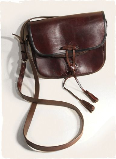 8e554aab033e Our saddle bag is crafted in mahogany leather