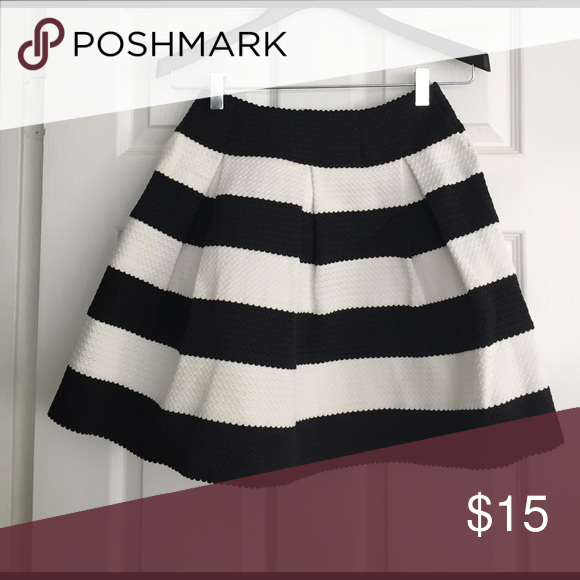 Black and white stripe skirt Xhilaration from Target.  It was large but customized to medium to tight little bit in. You can unsee to make large. Xhilaration Skirts