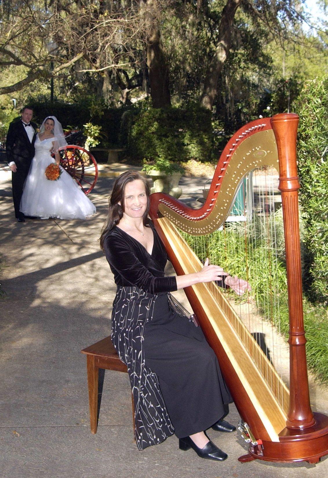 This wedding photo was taken just outside the White Garden at Leu Gardens in Orlando, FL  #leugardens #garden #wedding #harpist #bride