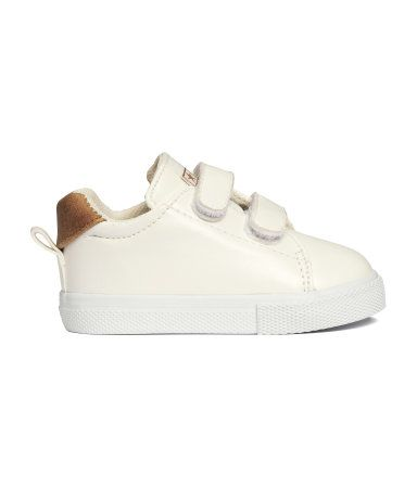 Sneakers in imitation leather with Velcro fastening at top. Fabric lining and rubber soles.