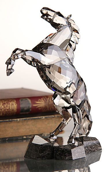 """Swarovski Stallion, Satin   $1,020.00 8 7/16""""   Item# 1074793  Dynamic and expressive, this stunning Soulmate sculpture captures the power and beauty of the stallion in motion. Shining in Crystal Satin on a Caffee Brown granite base, the stallion makes a strong statement in any surroundings. It comes with a cleaning cloth, gloves and card describing the animal's character."""