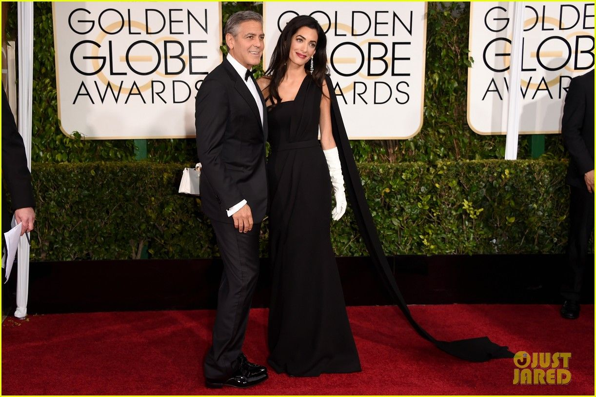 Amal Clooney looked glamorous in her long, flowing black Dior dress and long, white gloves  at the Golden Globes on Jan. 11. 2015.