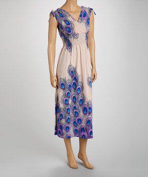 4a225972a5f Look at this  zulilyfind! jon   anna Creme Smocked Peacock Maxi Dress -  Women by jon   anna  zulilyfinds