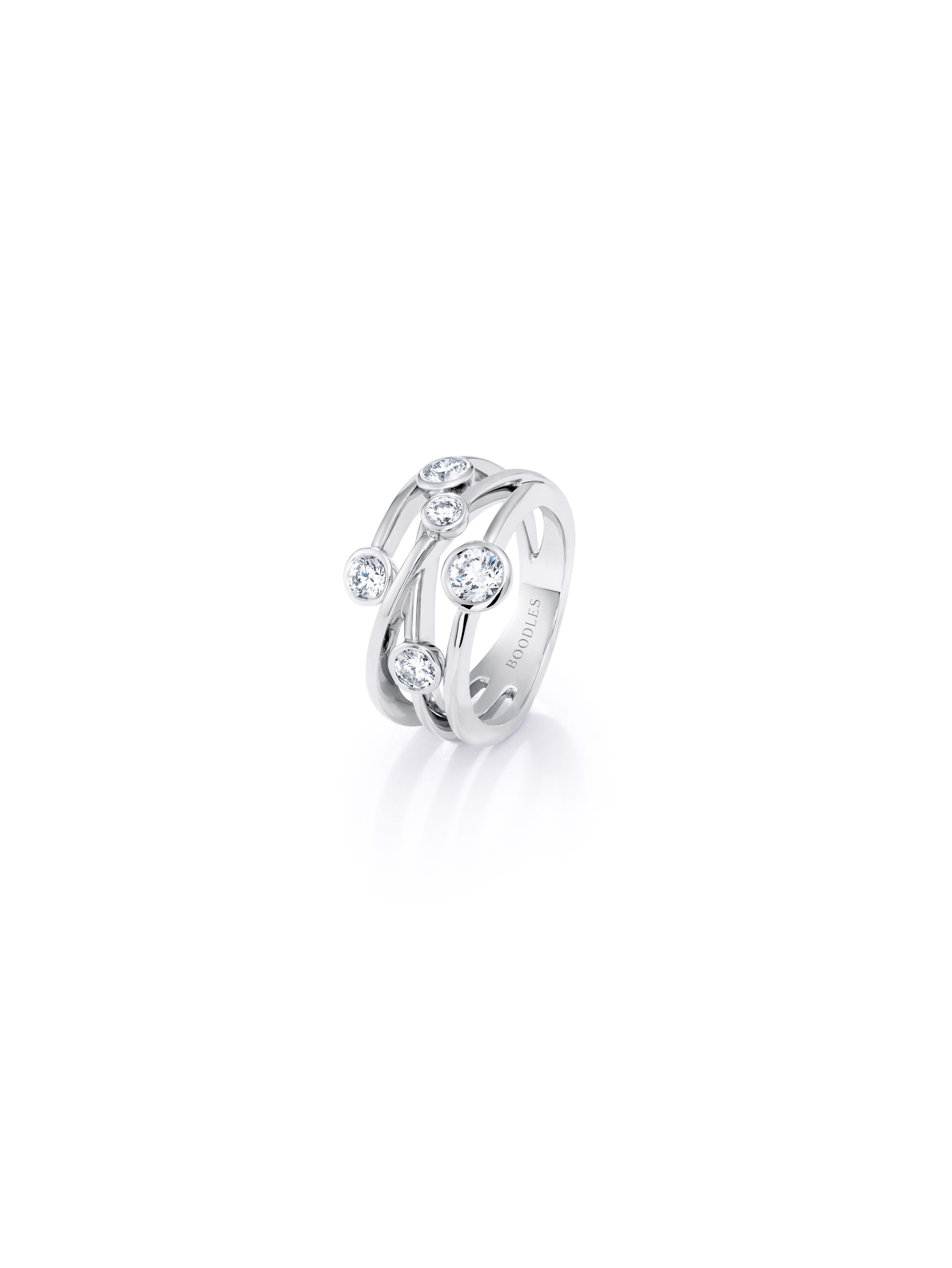 6af7a86dfbb304 Boodles 'Raindance Anniversary' ring featuring five diamonds set in  platinum.