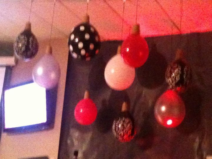 Christmas part idea, hang balloons upside down, use toilet paper roll as the top of the 'ornament' and hang from the ceiling