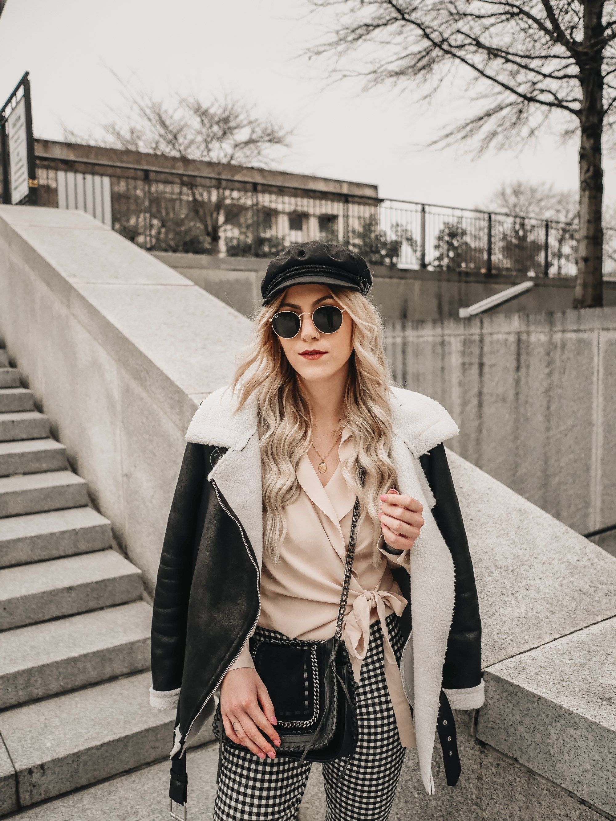 Cream top with checkered pants and a black leather jacket
