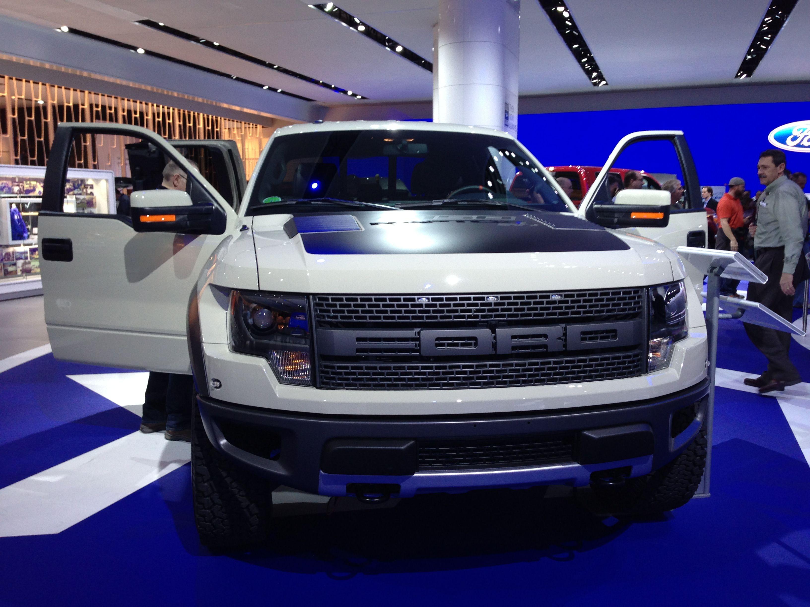 Doors open white ford f 150 svt raptor truck with black hood