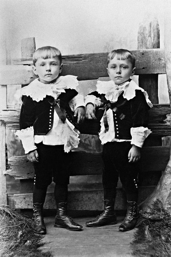 Little Lord Fauntleroy, times two? Antique photo: two little boys in fancy lace collars.