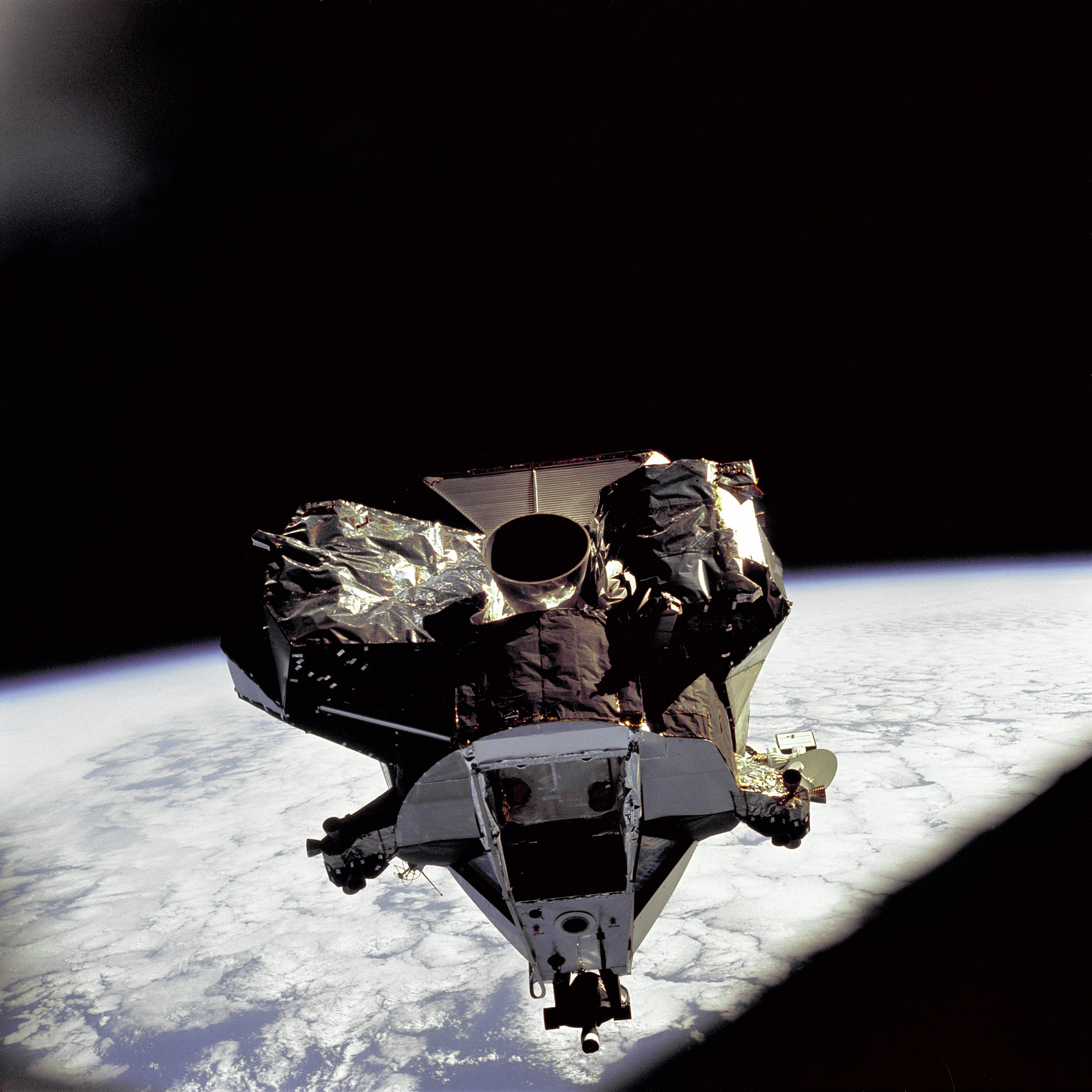 """The Lunar Module """"Spider"""" ascent stage is photographed from the Command/Service Module on the fifth day of the Apollo 9 earth-orbital mission. The Lunar Module's descent stage had already been jettisoned."""