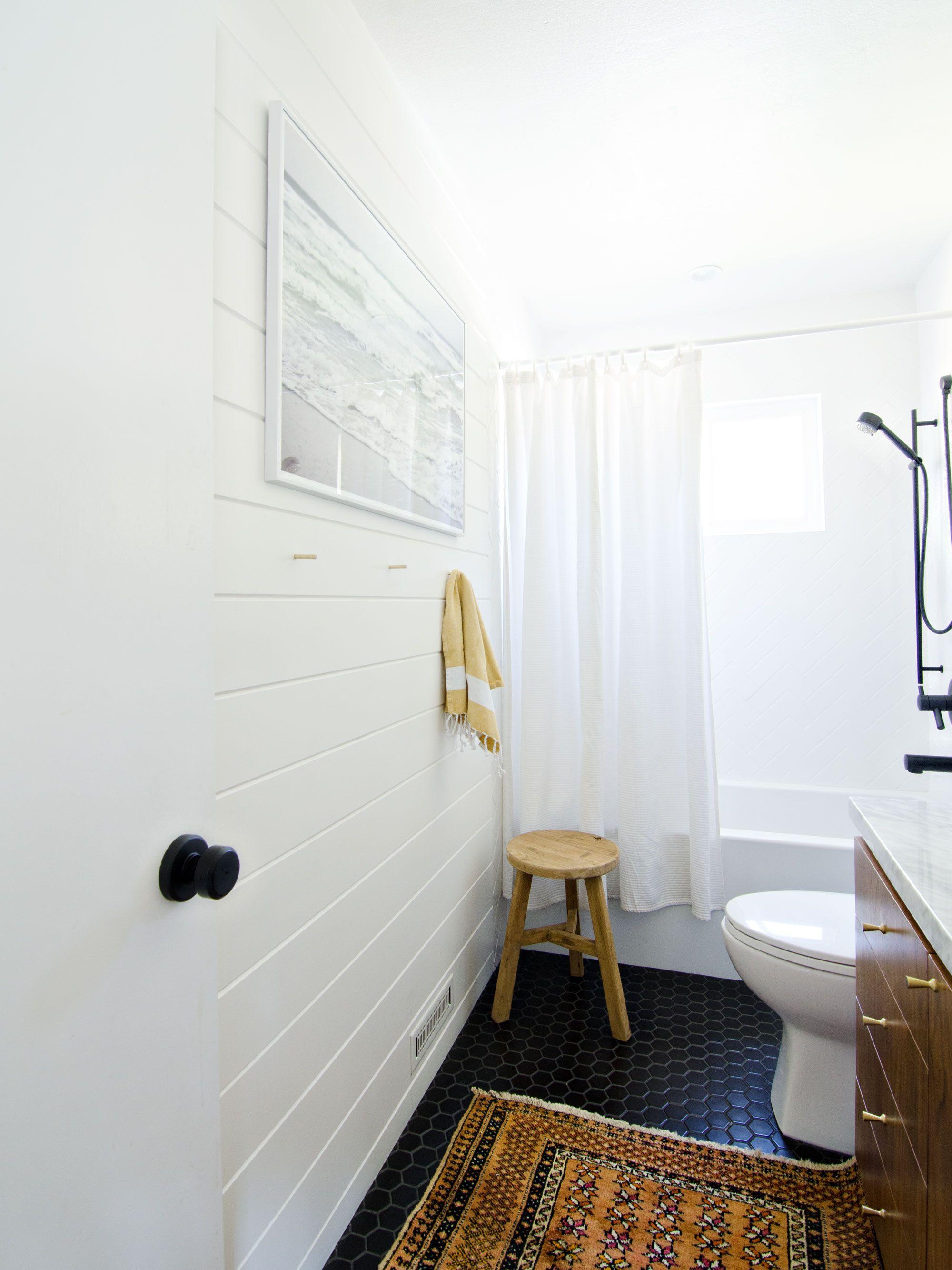 A Bathroom Has White Subway Tile And Dark Grout A Black And Walnut Vanity Has Black Drawer Pull Bathroom Light Fixtures Bathroom Black Fixtures Black Bathroom