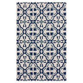 "Anchor your dining set or patio seating group in chic style with this lovely hand-hooked indoor/outdoor rug, showcasing a tile motif in ivory.  Product: RugConstruction Material: 100% PolypropyleneColor: IvoryFeatures:  Hand-hookedSuitable for indoor and outdoor usePile Height: 0.25"" Note: Please be aware that actual colors may vary from those shown on your screen. Accent rugs may also not show the entire pattern that the corresponding area rugs have."