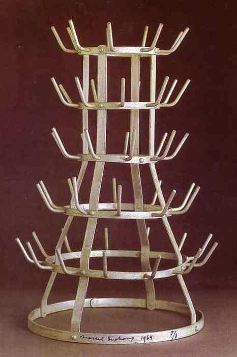 This dada sculpture has pattern and a asymmetrical shape. It is classified as a dada sculpture as it has no reasoning or purpose behind it.    http://containerlist.glaserarchives.org/index.php?id=44