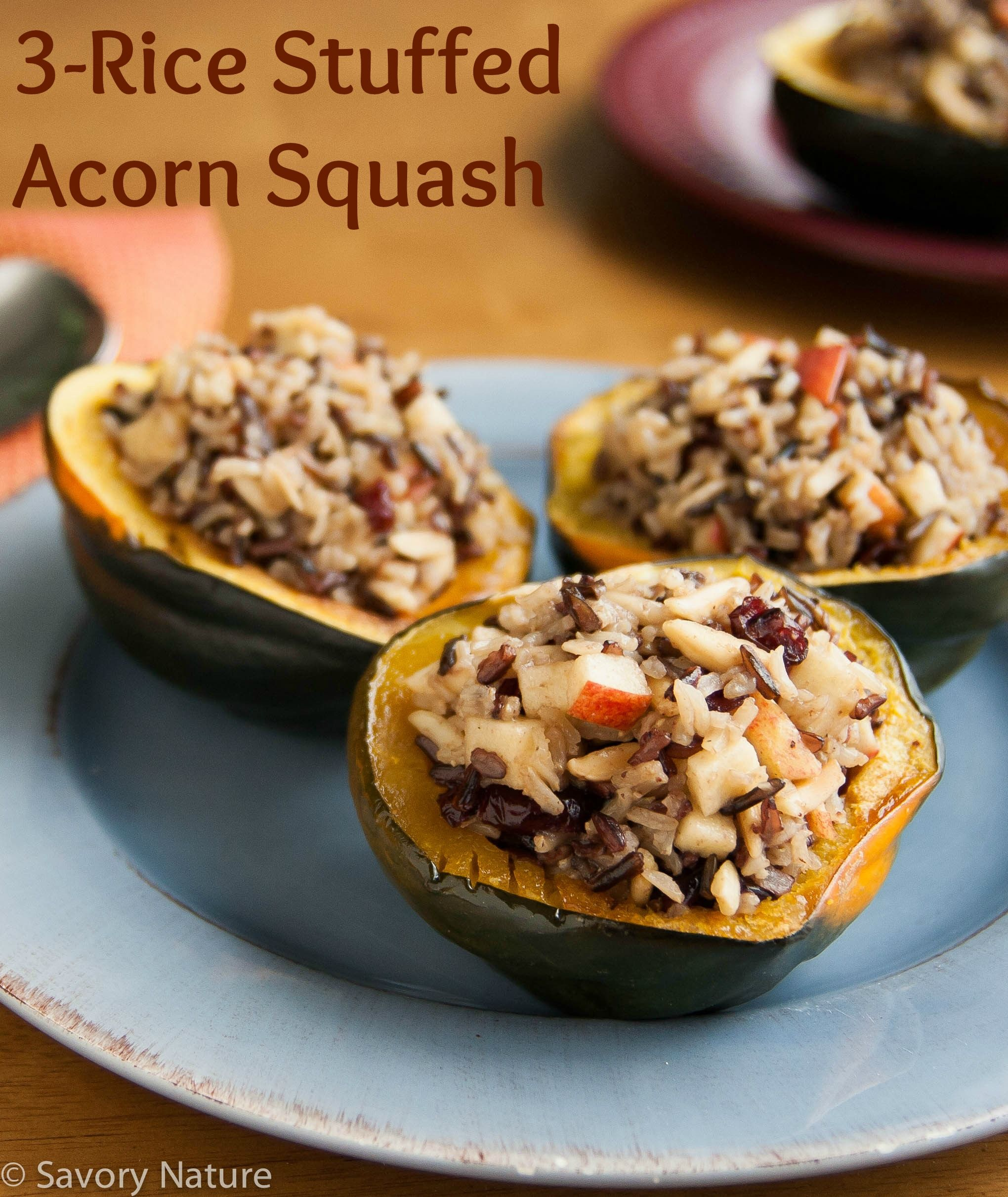 Three Rice Stuffed Acorn Squash - with a nutty, creamy, chewy mix of black, wild and brown basmati rices plus almonds, dried cranberries and apple sweetened with a little maple syrup - yummy and elegant!