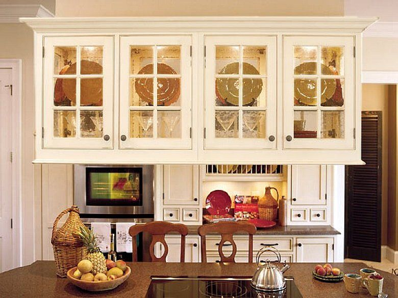 You can also choose the patterned glass cabinet doors to decorate ...