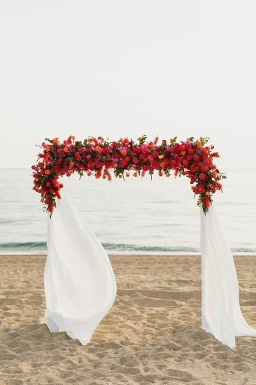Pink and orange floral arch. White Ribbon Boutique Events.