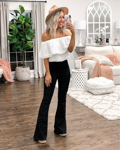 Comfy casual spring & summer vacation outfit  White crop top Black skinny/flare jeans Tan/black espadrille wedges Camel/black fedora #vacationoutfits